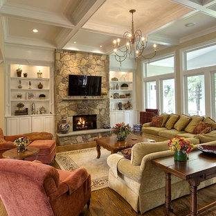 Large traditional formal open concept living room in DC Metro with a stone fireplace surround, a wall-mounted tv, a ribbon fireplace, beige walls, medium hardwood floors and brown floor.