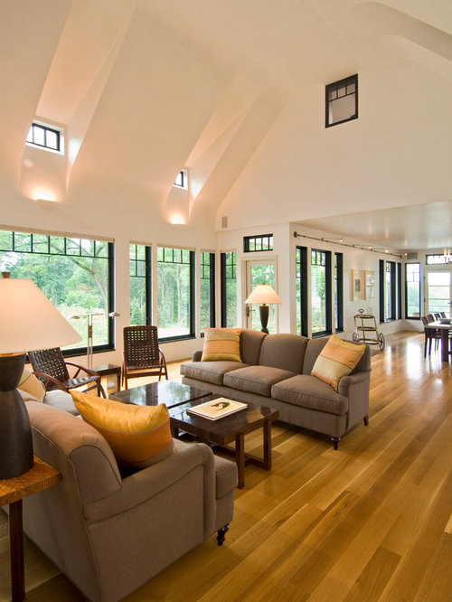 Huge contemporary open concept light wood floor living room idea in  Bridgeport with white walls,
