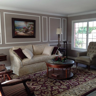 Living room - mid-sized traditional formal and enclosed laminate floor and brown floor living room idea in Orange County with gray walls