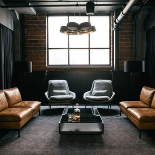 Urban living room in Minneapolis with brown walls, concrete flooring and black floors.