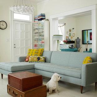 Example of an eclectic open concept light wood floor living room design in Atlanta with beige walls