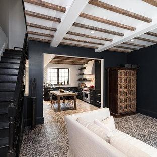 Ispirazione per un soggiorno contemporaneo di medie dimensioni e chiuso con sala formale, pareti nere, cornice del camino in mattoni, pavimento con piastrelle in ceramica, camino classico, nessuna TV e pavimento multicolore