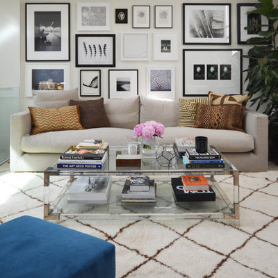 Living room - contemporary formal living room idea in London with white walls
