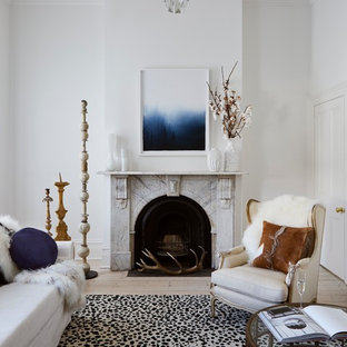 Design ideas for a transitional enclosed living room in Canberra - Queanbeyan with white walls, light hardwood floors, a standard fireplace and a stone fireplace surround.
