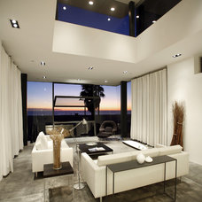 Modern Living Room by Equinox Architecture Inc. - Jim Gelfat