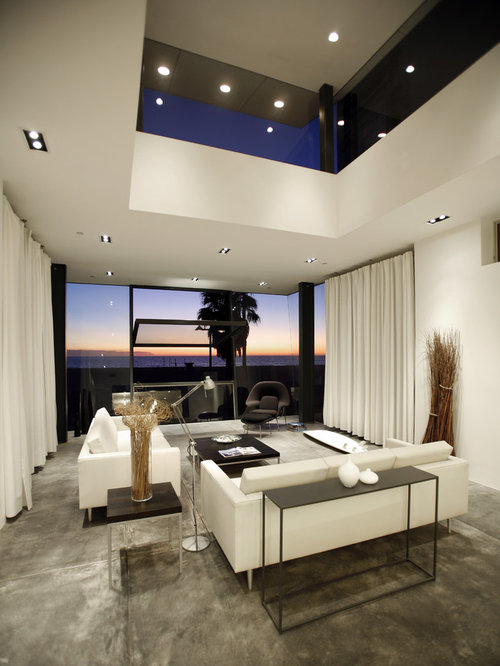colorful modern furniture. example of a minimalist concrete floor living room design in los angeles with white walls colorful modern furniture
