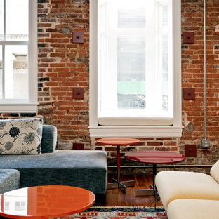 Living room - eclectic living room idea in Baltimore with red walls