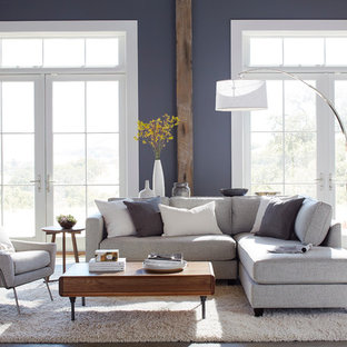 Large trendy formal and open concept concrete floor and gray floor living room photo in Manchester with gray walls