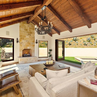 Example Of A Tuscan Light Wood Floor And Beige Living Room Design In Los Angeles