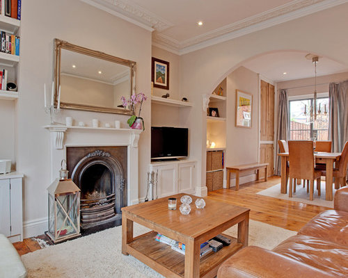 Victorian Enclosed Living Room In Other With A Standard Fireplace And A  Freestanding Tv.