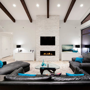 This is an example of a contemporary living room in Vancouver with white walls.