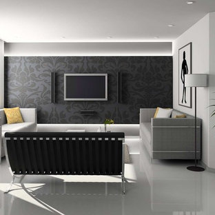 Small modern formal enclosed living room in London with black walls, porcelain flooring and a wall mounted tv.