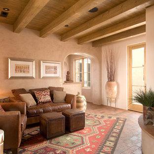 Ispirazione per un soggiorno american style di medie dimensioni e aperto con pavimento in mattoni, cornice del camino in cemento, sala formale, pareti beige, camino ad angolo, nessuna TV e pavimento marrone