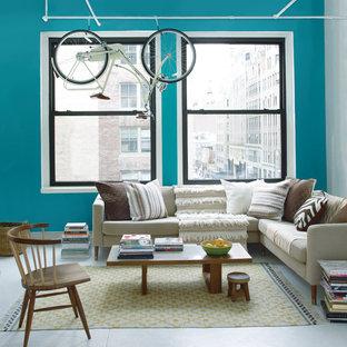 Esempio di un soggiorno boho chic di medie dimensioni e stile loft con sala formale, pareti blu, pavimento in cemento, nessun camino, nessuna TV e pavimento grigio