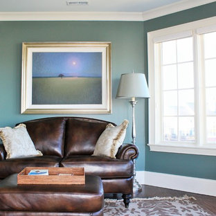 Small traditional living room in Indianapolis with blue walls and dark hardwood floors.