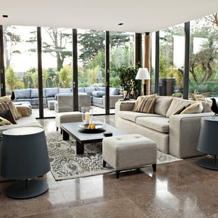 Photo of a contemporary formal living room in London with travertine floors.
