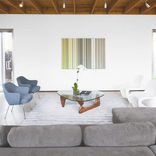 Modern Living Room by Intexure Architects