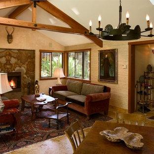サンフランシスコの中サイズのアジアンスタイルのおしゃれなLDK (ベージュの壁、トラバーチンの床、標準型暖炉、石材の暖炉まわり) の写真