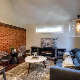 Ejemplo de salón para visitas cerrado, urbano, sin televisor, con paredes grises, marco de chimenea de piedra, suelo de madera oscura y chimenea lineal
