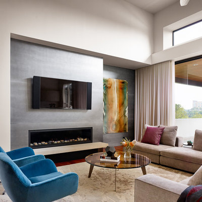 Inspiration for a large contemporary open concept medium tone wood floor living room remodel in Austin with white walls and a wall-mounted tv