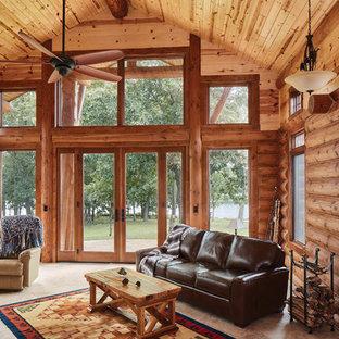 Diseño de salón abierto, rural, de tamaño medio, sin televisor, con paredes marrones y suelo gris