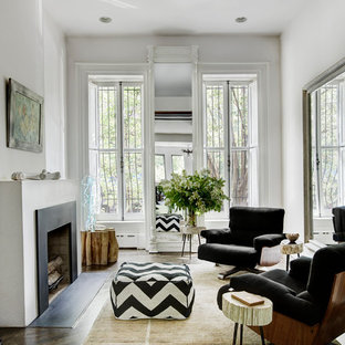 Trendy dark wood floor living room photo in New York with white walls and a standard fireplace