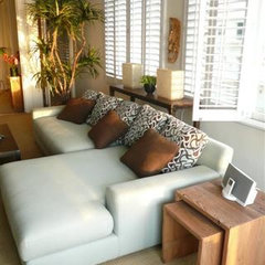 tropical living room by Square One Interiors