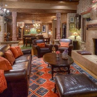 フェニックスの中サイズのサンタフェスタイルのおしゃれなLDK (フォーマル、コンクリートの床、標準型暖炉、コンクリートの暖炉まわり、テレビなし、茶色い床) の写真