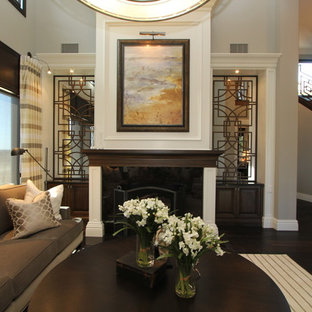 Example of a classic dark wood floor living room design in San Diego with a standard fireplace