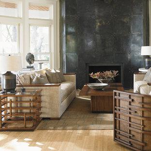 オレンジカウンティの中サイズのアジアンスタイルのおしゃれなLDK (ベージュの壁、淡色無垢フローリング、標準型暖炉、コンクリートの暖炉まわり、テレビなし) の写真