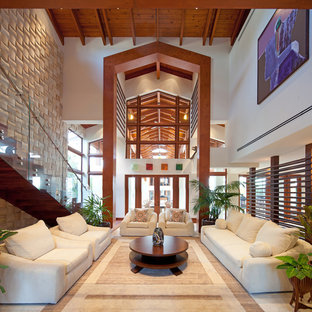 Living room - tropical living room idea in Miami with white walls