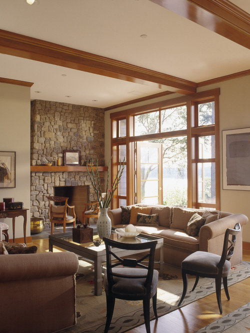Inspiration for a timeless living room remodel in Seattle with beige walls,  a standard fireplace