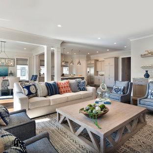 Immagine di un soggiorno stile marino aperto con pareti bianche, parquet scuro e pavimento marrone