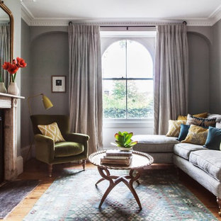 Inspiration for a classic formal living room in London with grey walls, light hardwood flooring, a standard fireplace and no tv.