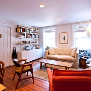 Living room - mid-sized eclectic medium tone wood floor living room idea in New York with white walls