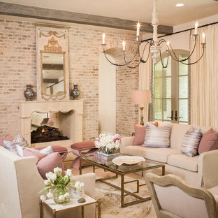 This is an example of a mediterranean formal living room in Dallas with beige walls and a two-sided fireplace.