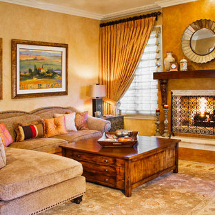 Inspiration for a mediterranean enclosed living room remodel in Los Angeles with a standard fireplace