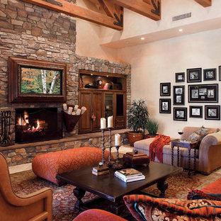 Example of a classic formal and enclosed travertine floor living room design in Dallas with beige walls and a stone fireplace