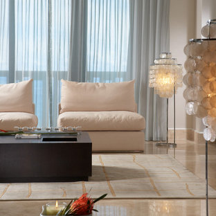 Example of a mid-sized minimalist formal and open concept marble floor and beige floor living room design in Miami with white walls