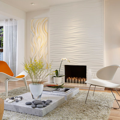 Inspiration for a mid-sized contemporary open concept light wood floor living room remodel in Miami with a standard fireplace and white walls