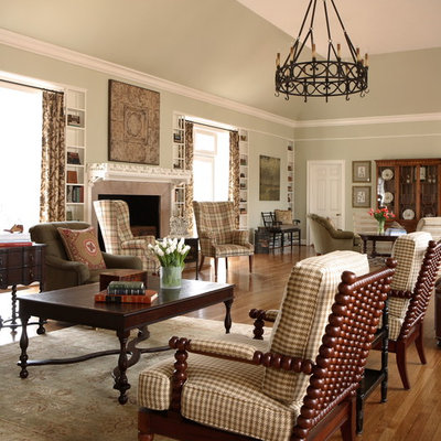 Example of a classic living room design in Atlanta with green walls