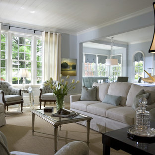 Example of a large classic living room design in Atlanta with blue walls