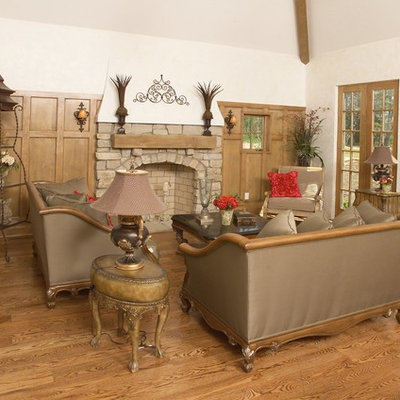 Inspiration for a transitional living room remodel in Cleveland with a standard fireplace