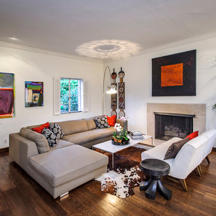 Inspiration for a mid-sized contemporary dark wood floor and brown floor living room remodel in San Francisco with a standard fireplace, white walls and a stone fireplace