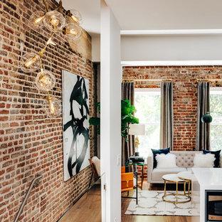 Imagen de salón tipo loft, moderno, pequeño, con paredes blancas, suelo de madera en tonos medios y chimenea tradicional