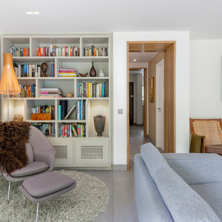 This Is An Example Of A Midcentury Enclosed Living Room In London With White Walls And
