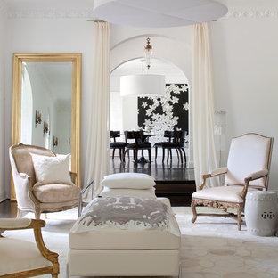 Foto de salón para visitas actual con paredes blancas