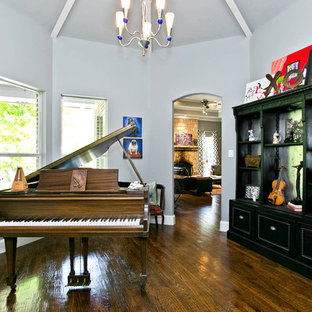 Example of a transitional dark wood floor living room design in Dallas with a music area, gray walls and no tv