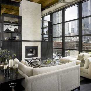 This is an example of an industrial open concept living room in Chicago with a two-sided fireplace.