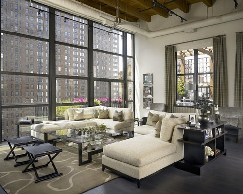 Inspiration For A Huge Industrial Living Room Remodel In Chicago With White  Walls